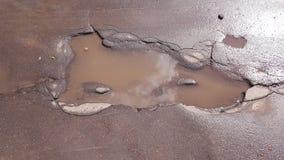 Un foro nell'asfalto Fotografie Stock Libere da Diritti