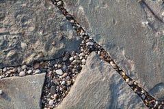 Un fragment des tuiles en pierre Photo stock
