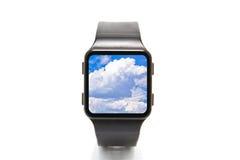 Un fronte di orologio ed il cielo Immagini Stock