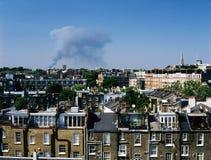 Un fuego y la opinión de la ciudad de Londres, Reino Unido Imagen de archivo libre de regalías