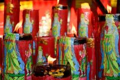 Un fuego y una vela Imagen de archivo libre de regalías