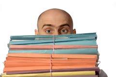 Un funcionario y su papeleo imagenes de archivo