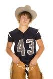 Un futbolista en sombrero y grietas de vaquero Imagen de archivo libre de regalías