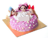 Un gâteau créatif de trois filles s'asseyant dans la baignoire Photo libre de droits