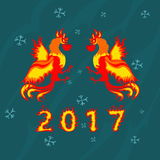 Un gallo di due fuochi, simbolo 2017 sul calendario cinese Fotografie Stock Libere da Diritti