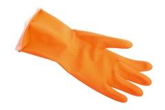 Un gant en caoutchouc orange. Photographie stock libre de droits