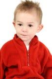 Un garçon adorable d'ans dans le chandail rouge Photographie stock