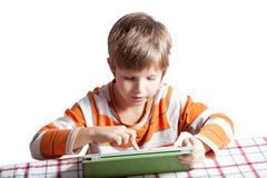 Un garçon avec une tablette Photographie stock