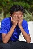 Un garçon déçu d'adolescent image stock