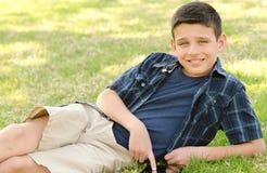 Enfant avec le comprimé Photographie stock