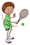 Un garçon jouant au tennis Photo libre de droits