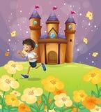 Un garçon jouant devant le château illustration stock