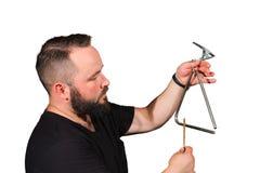 Un giocatore di triangolo di percussione Fotografie Stock