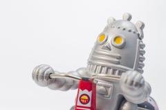 Un giocattolo del robot sta guidando la bicicletta Fotografie Stock Libere da Diritti
