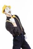 Un giovane felice, un attore, pantomimo, si rallegra nel successo Immagine Stock Libera da Diritti