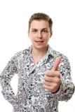 Un giovane, indicante il suo pollice in su Immagine Stock Libera da Diritti