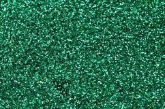 Un gran quantità degli zecchini decorativi verdi Struttura del fondo con gli elementi brillanti e piccoli che riflettono la luce  Fotografie Stock