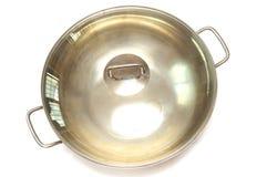 Un grand wok avec le double couvercle supérieur de poignée et en verre Photos stock