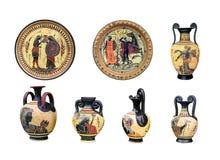 Un grande insieme dei vasi e dei piatti del greco antico su un backgro bianco Fotografia Stock