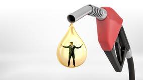 Un grande ugello del passaggio del gas rosso che cola una goccia gialla gigante dell'olio con un uomo d'affari minuscolo che sta  Fotografia Stock