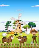 Un granjero con los animales del campo Fotografía de archivo libre de regalías