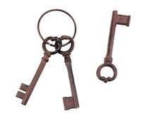 Un groupe de clés antiques et d'une clé simple Photographie stock libre de droits