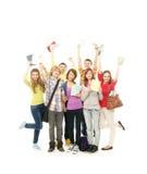 Un groupe de jeunes adolescents retenant des cahiers Images libres de droits