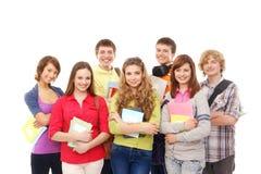 Un groupe de jeunes adolescents retenant des carnets Images libres de droits