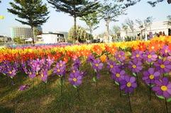 Un groupe de moulin à vent de fleur de jouets Photographie stock