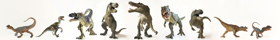 Un groupe de neuf dinosaures dans une rangée images libres de droits