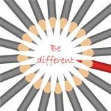 Un grupo de lápices grises estándar y de un rojo con lema - sea dif Fotos de archivo libres de regalías
