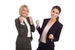 Un gruppo di due ha isolato la donna di affari che celebra il suo successo e Fotografia Stock