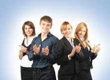 Un gruppo di quattro persone di affari che applaudono le mani Fotografia Stock