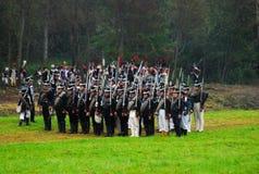 Un gruppo di supporto degli uomini con le pistole. Fotografie Stock