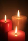 Un gruppo di tre candele burning Fotografie Stock Libere da Diritti