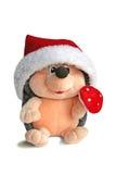 Un hérisson de jouet décoré pour Noël. Jouet pelucheux. Photos stock