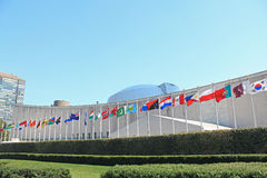 UN Headquarters in New York. UN Flags colorful flags of the world in front of United Nations Building in New York City stock photos