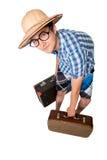 Un hombre atractivo joven con los vidrios y el suitca dos Fotos de archivo libres de regalías