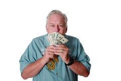 Un hombre con el dinero Un hombre gana el dinero Un hombre tiene dinero Un hombre huele el dinero Un hombre ama el dinero Un homb fotografía de archivo libre de regalías