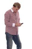 Un hombre con el teléfono móvil Fotografía de archivo libre de regalías