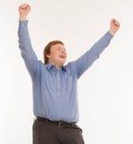 Un hombre con las manos para arriba en el aire Aislado en el fondo blanco Imágenes de archivo libres de regalías