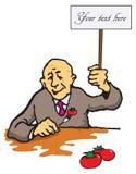 Un hombre con un tomate Imagen de archivo libre de regalías