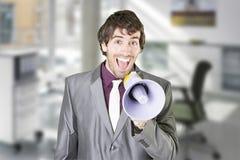 Un hombre de negocios con el megáfono Fotos de archivo