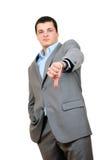 Un hombre de negocios con los pulgares abajo Imagen de archivo