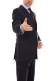 Un hombre de negocios con una mano abierta lista para sellar una d Foto de archivo
