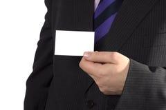 Un hombre de negocios con una tarjeta en blanco Imagen de archivo