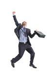 Un hombre de negocios joven feliz que salta en el aire Fotografía de archivo