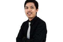 Un hombre de negocios más joven que sonríe y amistoso Imagen de archivo libre de regalías