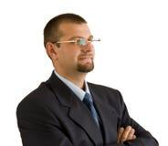Un hombre de negocios maduro confidente en el fondo blanco Foto de archivo