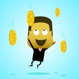 Un hombre de negocios salta y coge las monedas que caen del cielo Imagenes de archivo
